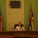 Laura presiding